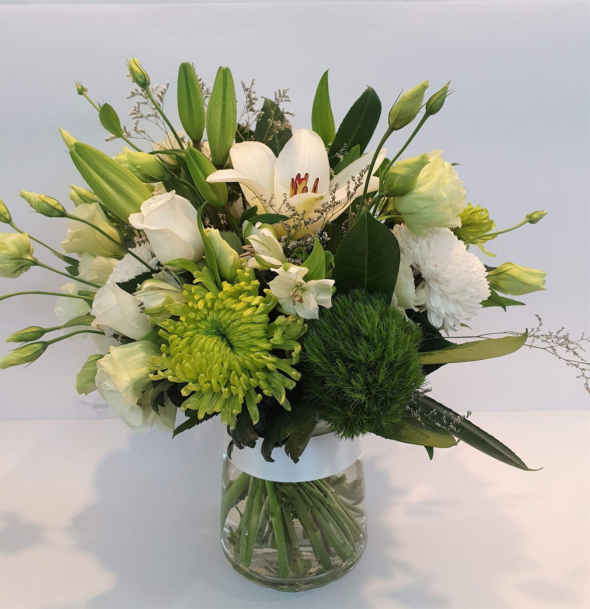 Simplicity - Elegant green and white bouquet in a glass vase. Medium height suitable to sit on a table - Sympathy / Funerals,Any Occasion,Mothers Day